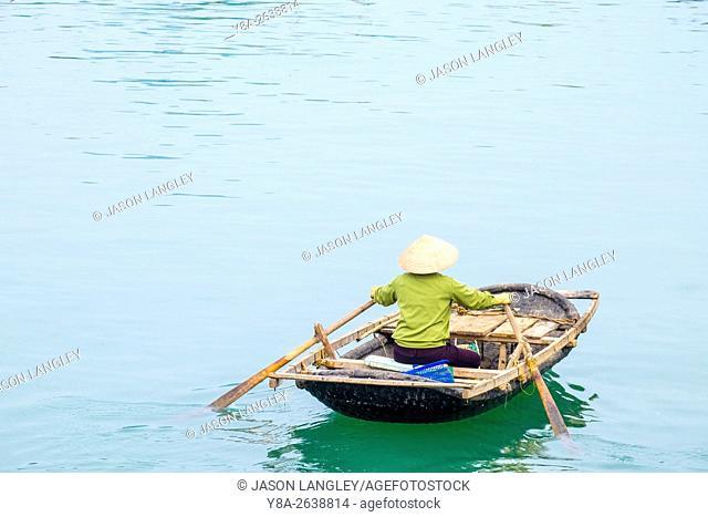 Woman in small sampan boat on Ha long Bay, Cai Rong, Quang Ninh Province, Vietnam