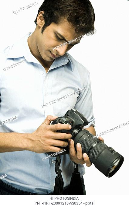 Photographer checking a digital camera