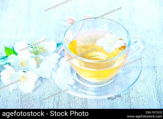 jasmin tea in glass cup and on a table