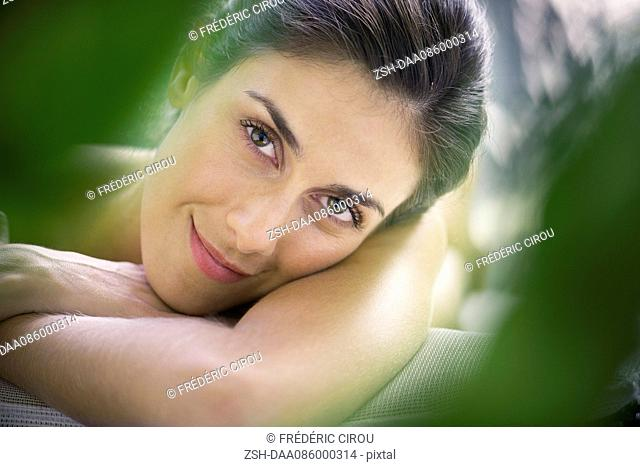 Woman relaxing at spa, portrait