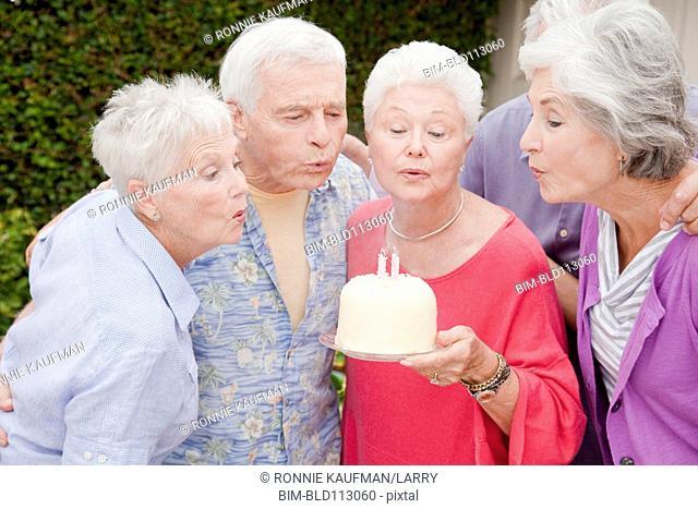 Older Caucasian friends celebrating birthday