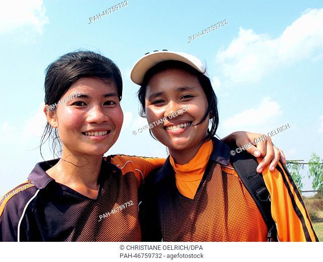 "Members of the women's soccer team """"Mighty Girls"""" Socheata Seng (19, L)and Linda Chourn (19) pose during training in Battambang, Cambodia, 13 February 2014"