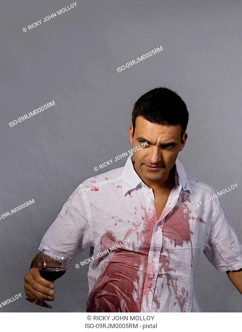 Man with red wine on his shirt
