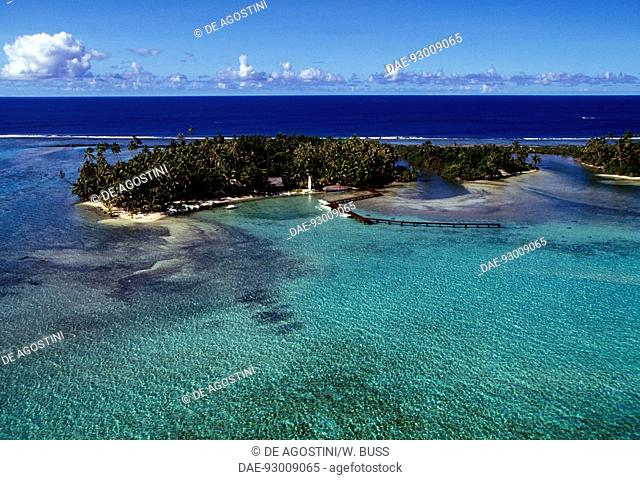 Motu Tuuvahine covered in vegetation and surrounded by clear waters, aerial view, Bora Bora, Society islands, French Polynesia