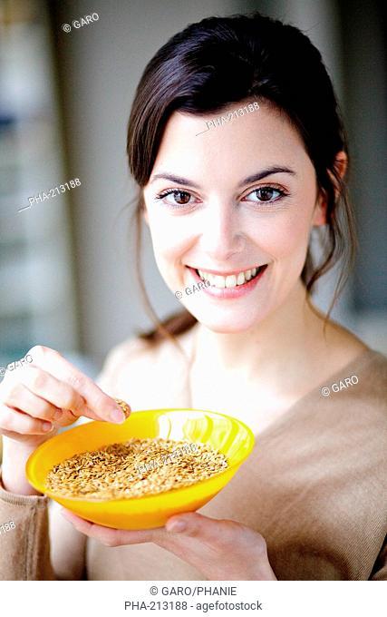 Woman eating golden flax seeds