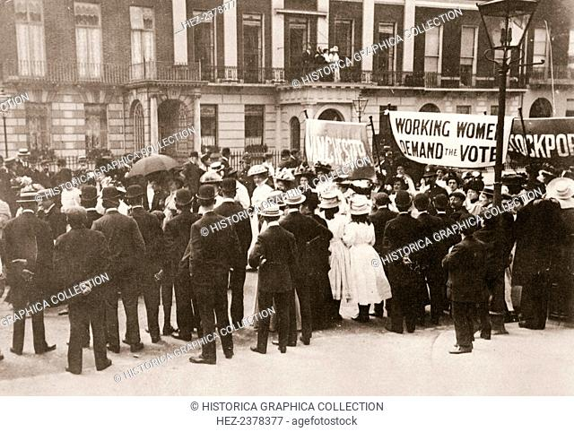 Spectators gather on Portland Place to watch the Women's Sunday procession, London, 21 June 1908. On Sunday 21 June 1908 thousands of people gathered in London...
