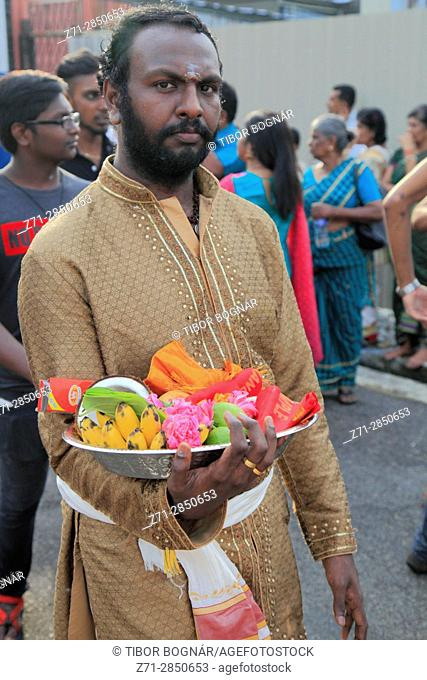 Malaysia, Penang, Thaipusam, hindu festival, man with offerings,