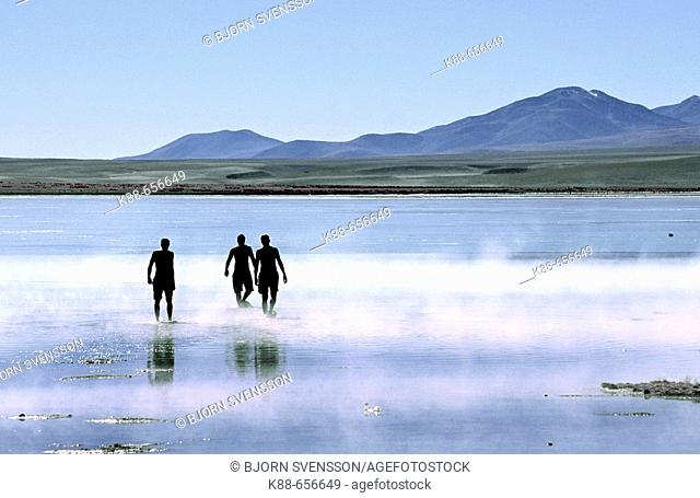 Tourists bathing in hot springs. Termas de Polques, Reserva Nacional Eduardo Avaroa, Bolivia
