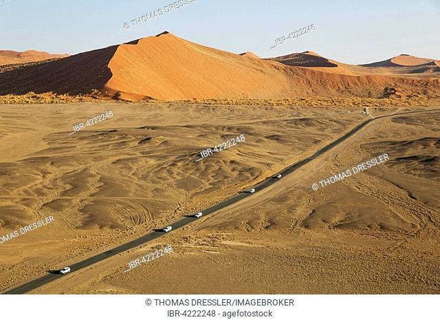 Paved road connecting Sesriem and the famous Sossusvlei in the heart of the Namib Desert, runs between spectacular sand dunes, aerial view