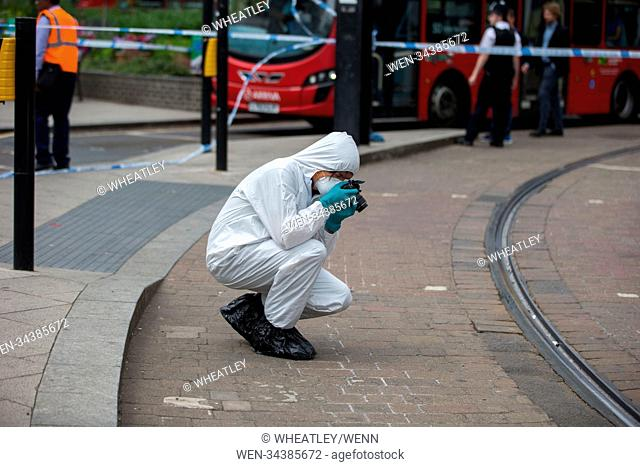 Police in attendance at crime scene. Suspected stabbing, George Street, East Croydon, London, UK. Featuring: Atmosphere, View Where: London, England