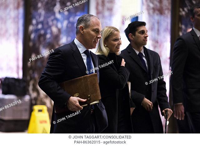 Attorney General Scott Pruitt (Republican of Oklahoma), left, arrives at Trump Tower in Manhattan, New York, USA, on Wednesday, December 7, 2016