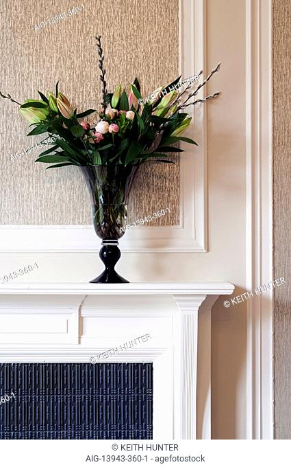 Flower arrangement on mantelpiece, Devonshire Terrace, Glasgow, Scotland, UK