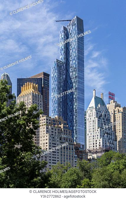 Residential skyscraper One57 towers over Central Park and other nearby buildings in New York City