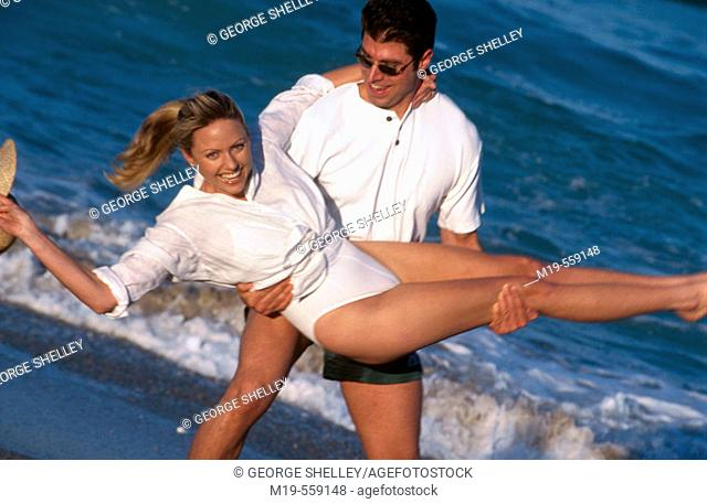 carefree couple at the beach