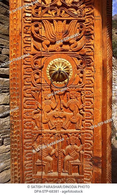 Wood carving on Gate of Palace Kamru , Himachal Pradesh , India