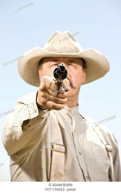 Close up of a cowboy aiming his gun