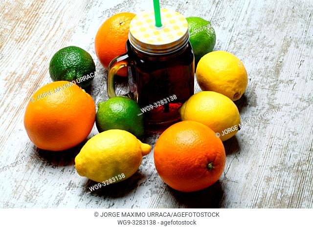 Lemons, Oranges and Limes with fruit juice