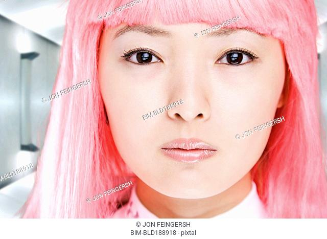 Close up of Chinese woman in pink wig