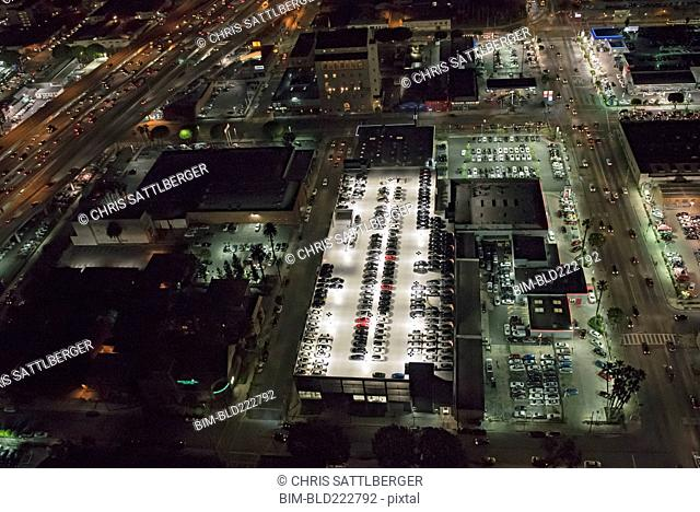Aerial view of rooftop parking lot lit up at night