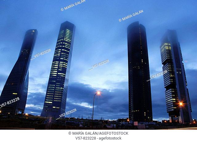 Cuatro Torres Business Area in the mist, at dawn. Madrid, Spain