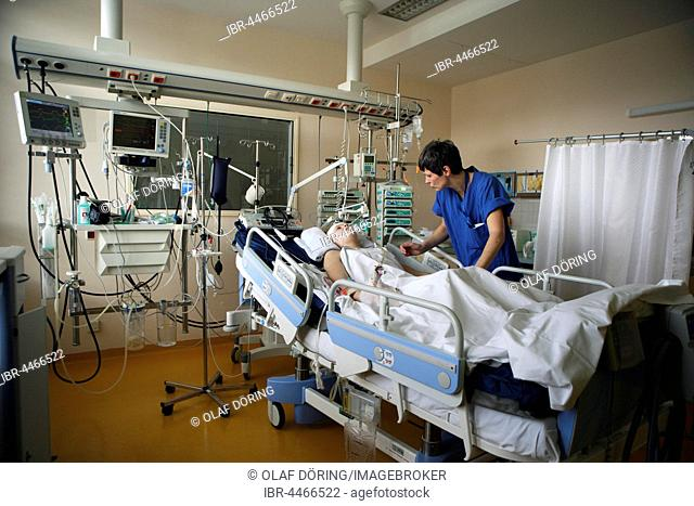 Child in hospital bed is attended by intensive care nurse, Intensive Care Unit, Children's Hospital Altona, Hamburg, Germany