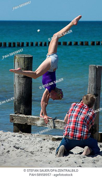 Circus artist Melina poses for the photographers from the Horizonte Zingst environmental photo festival on the Baltic Sea in Zingst, Germany, 05 June 2015