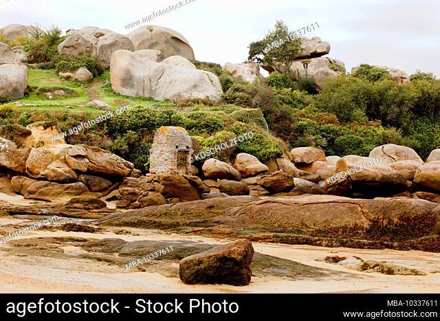 France's famous rocky coastline of the Cote de Granit Rose in Brittany. Famous for its massive granite blocks