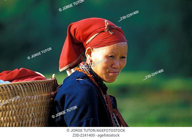 A Red Dao young woman with their traditional costumes with colorful patterns Ta Phin Village Sapa Vietnam