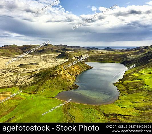 Highlands with lake in nature