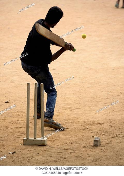 Children playing cricket in Bangalore, Karnataka, India