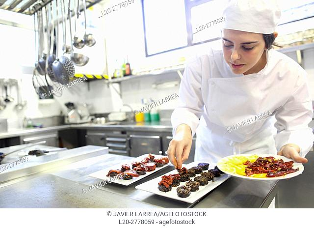 Chef plating blood sausage with red pepper, Cook in cooking school, Cuisine School, Donostia, San Sebastian, Gipuzkoa, Basque Country, Spain, Europe