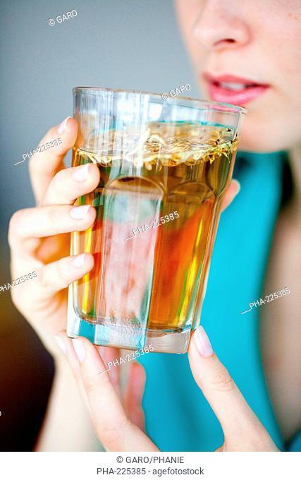 Woman drinking hot beverage