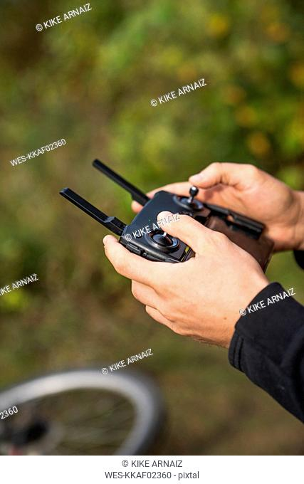 Man using a telecontrol outdoors
