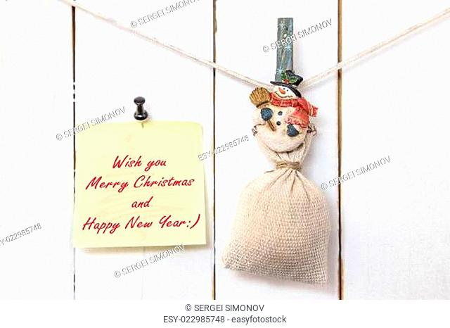Snowman clothespin holding sack and Christmas greeting note