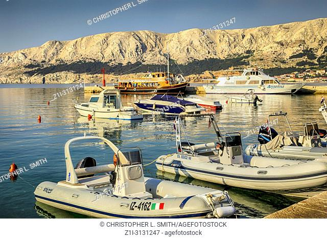 Variety of boats in the Croatian harbor village of Baska on the Island of Krk