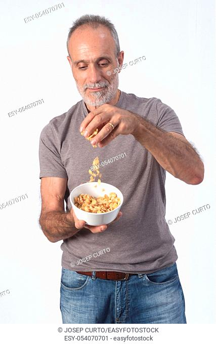 man with corn flakes bar on white background