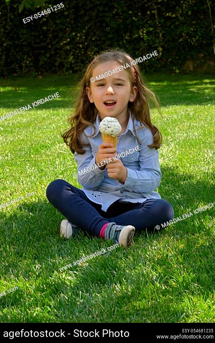 Little Girl Singing with A Ice Cream Microphone In Waffle Cone