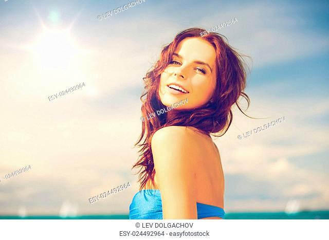 close up of beautiful woman in bikini smiling