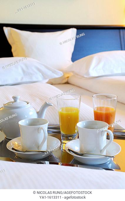 French continental breakfast in bed, hotel room, Paris