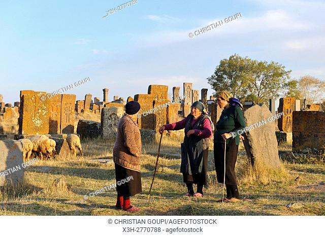 shepherdess at Noratus cemetery (the largest surviving cemetery with khachkars in Armenia), near Lake Sevan, Gegharkunik region, Armenia, Eurasia