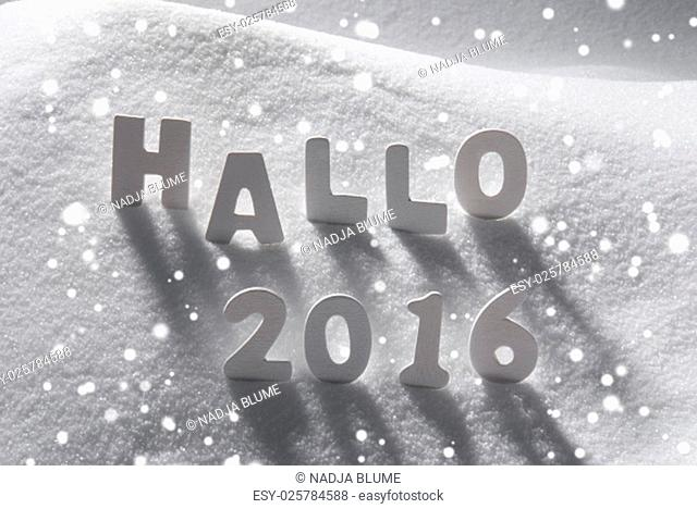 White Wooden Letters Building German Text Hallo 2016 Means Hello 2016. Snow And Snowy Scenery With Snowfalkes. Christmas Atmosphere