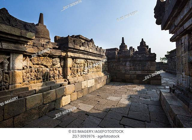 Elaborate reliefs on the walls of Borobudur Temple, Java, Indonesia