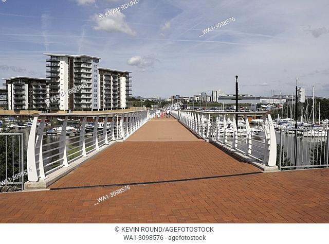 Pont y Werin footbridge across the River Ely in Cardiff Bay, Wales UK