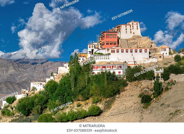 Thiksay monastery with view of Himalayan mountians and blue sky in background, Ladakh, Jammu and Kashmir, India