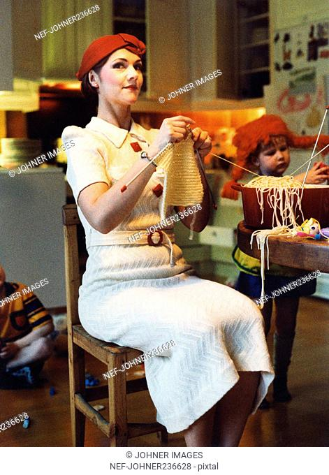 A Woman Knitting with Spaghetti