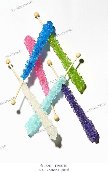 Various sugar sticks on a white surface