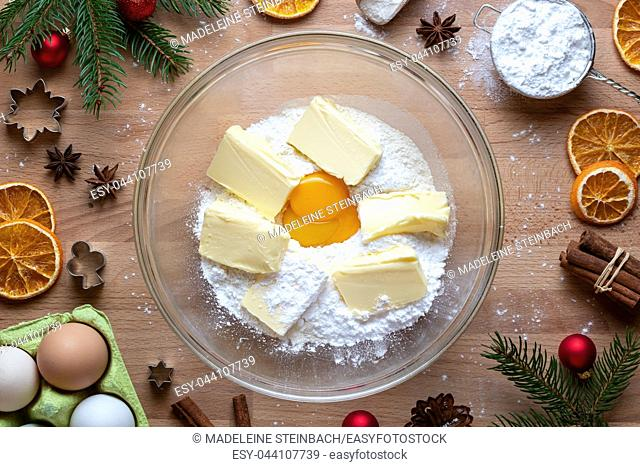 Flour, sugar, egg yolk and butter - ingredients to prepare traditional Linzer Christmas cookies