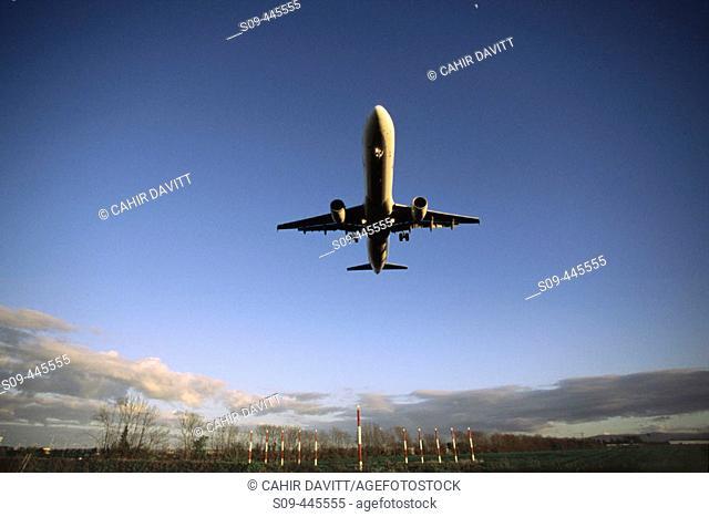 Aer Lingus airbus A320 landing at Dublin airport on runway 34 at sunset