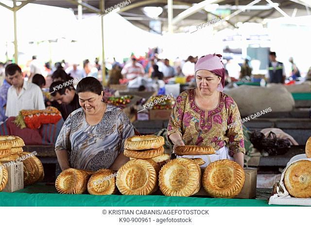 Two local women selling traditional bread on Chorsu Bazaar, Tashkent, Uzbekistan, Central Asia