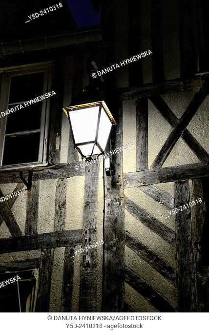 lantern on street of Honfleur, in background half-timbered wall, Normandy, France